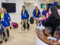 Bermuda's CARIFTA Medal Winning Swimmers Touch Down on Home Ground From Jamaica