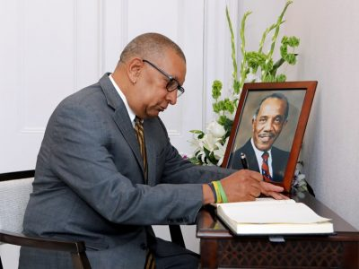 Minister Signs Condolence Book Following the Passing of CV 'Jim' Woolridge, CBE, JP