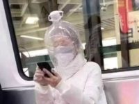 Coronavirus Panic Sees Commuters Wearing Plastic Boxes & Carrier Bags Over Their Heads