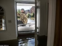 Homes Almost Totally Under Water as Yet Another Storm Batters Britain With 70 mph Winds