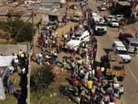 Thousands Of Hungry People Line Up For Food In South Africa