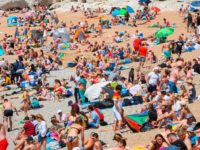 Thousands Flout Beach Closures & Walk Five Miles to Sunbathe During UK Lockdown