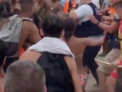 Massive Brawl Breaks Out On Beach With Umbrellas & Sunbeds Used As Weapons