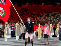 First-Time Olympian Dara Alizadeh Proudly Carries Bermuda Flag At Olympic Opening Ceremony