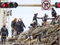 Search for survivors in Florida building collapse abruptly halted over fears that remaining structure could fall